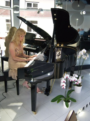 Rosalind playing Suzuki Grand Piano